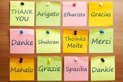 Thank you word in 12 languages. Thank you word post it in 12 languages stock photo