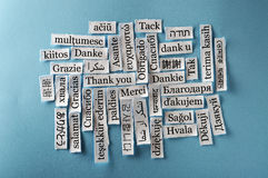 Thank You. Word Cloud  printed on  paper on blue font Stock Photography