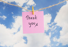 Thank you 6. Word Thank you on colorful note paper hang with rope with blue sky background Royalty Free Stock Images