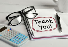 Thank you word. Writing on notebook royalty free stock photography