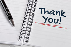 Thank you word. Written on  notebook page Royalty Free Stock Photo
