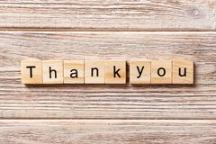 Thank you word written on wood block. thank you text on table, concept.  Stock Photos