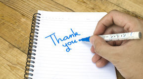 Thank you wording on a book by hand Royalty Free Stock Images