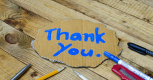 Thank you wording on cardboard Royalty Free Stock Photo
