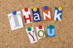 Thank You. The words Thank You in cut out magazine letters pinned to a cork notice board Stock Image