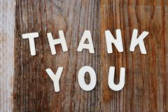 Thank you words on wooden background Stock Photo