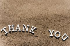 Thank you word drawn on the beach sand royalty free stock image