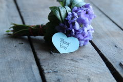 Thank you, written on heart. Thank you written on tag and a bouquet of violets Royalty Free Stock Photos