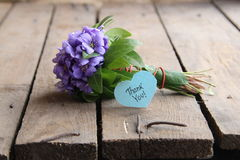 Thank you, written on label. Thank you written on tag and a bouquet of violets Stock Photos