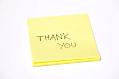 Thank you written on a post-it or a sticky note, isolated on white. Background Stock Photo