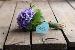 Thank you, written on tag. Thank you written on tag and a bouquet of violets Stock Photos