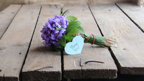Thank you, written on tag and flowers. Thank you written on tag and a bouquet of violets stock video footage