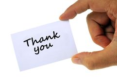 Thank you written on a white card close up royalty free illustration