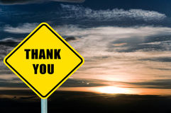 Thank you. Yellow road sign with clouds and sky in background stock photos