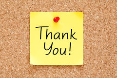 Thank You On Yellow Sticky Note. Thank You handwritten on yellow sticky note pinned on bulletin cork board stock photo