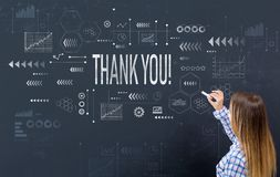Thank you with young woman. Writing on a blackboard royalty free stock images