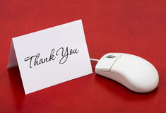 Thank You for your online purchase. A computer mouse with a thank you card on a red background, Thank You for your online purchase Stock Photography