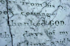 Thanked God. Partial view of a tombstone centering on the words thanked God Stock Photography