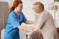 Thankful admirable woman greeting her nurse
