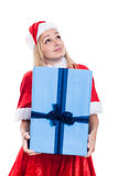 Thankful Christmas woman holding big present. And looking up, isolated on white background Royalty Free Stock Images