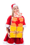 Thankful Christmas woman holding presents. Thankful Christmas woman holding many presents and looking up, isolated on white background Stock Photos