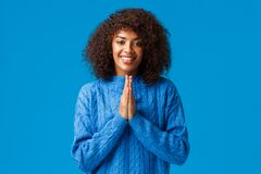 Thankful cute smiling african-american pretty woman with afro haircut, saying arigato and smiling, clasp hands together