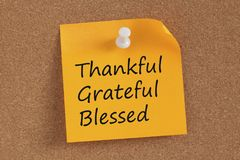 Thankful,Grateful and Blessed written on note. Thankful,Grateful and Blessed written in remember note pinned on a cork board stock photos