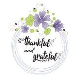 Thankful grateful hand drawn text into flower wreath Stock Photos