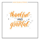 Thankful and grateful lettering with black splashes