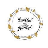 Thankful and grateful text in autumn gold wreath of leaves. Happy Thanksgiving day card, thankful and grateful text in autumn gold wreath of leaves, handwritten Royalty Free Stock Photos
