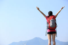 Thankful hiking woman mountain peak. Thankful hiking young asian woman open arms at seaside mountain peak Stock Photography