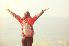 Thankful hiking woman mountain peak Royalty Free Stock Photo
