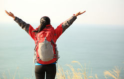 Thankful hiking woman mountain peak Stock Photo