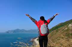 Thankful hiking woman seaside mountain Royalty Free Stock Photos
