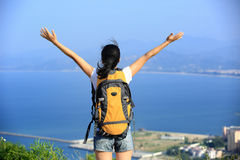 Thankful hiking woman seaside mountain Royalty Free Stock Photography
