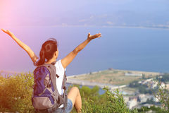 Thankful hiking woman seaside mountain. Thankful hiking young asian woman open arms at seaside mountain peak Royalty Free Stock Images