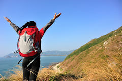 Thankful hiking woman seaside mountain Royalty Free Stock Image