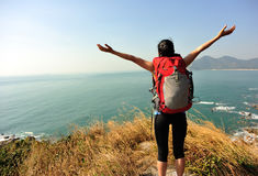 Thankful hiking woman seaside mountain Stock Photography