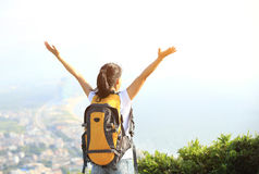 Thankful hiking woman seaside mountain Stock Photo