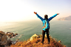 Thankful hiking woman seaside Stock Photos