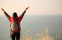 Thankful hiking woman seaside Stock Photography