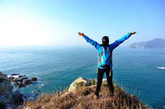 Thankful hiking woman seaside Royalty Free Stock Photography