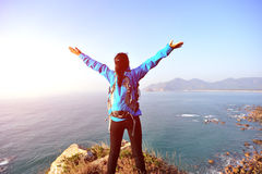 Thankful hiking woman seaside Stock Images