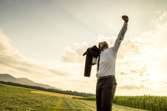 Thankful Man in the Field Raising Arm for Success Royalty Free Stock Photo