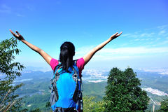 Thankful mountain climbing woman Stock Photography