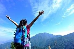 Thankful mountain climbing woman Stock Photos