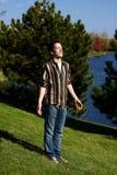Thankful teen boy. Handsome teen boy enjoying sunshine with eyes closed Stock Image