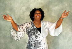 Thankful Woman. This woman is thankful and gives praise as she lifts her arms in the air Stock Images