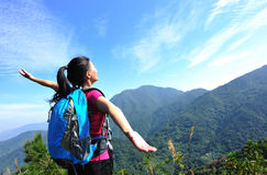 Thankful woman climber. Thankful hiking woman climber open arms mountain peak Stock Photography