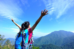 Thankful woman climber. Thankful hiking woman climber open arms mountain peak Stock Images
